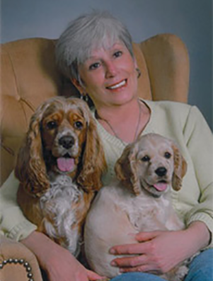 Photo of Carmella Williams and her two dogs